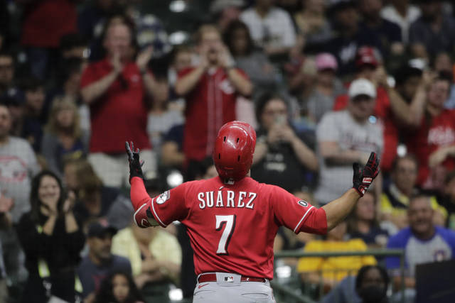 Cincinnati Reds' Eugenio Suarez gestures after hitting a solo home run during the ninth inning of a baseball game against the Milwaukee Brewers, Saturday, July 10, 2021, in Milwaukee. (AP Photo/Aaron Gash)
