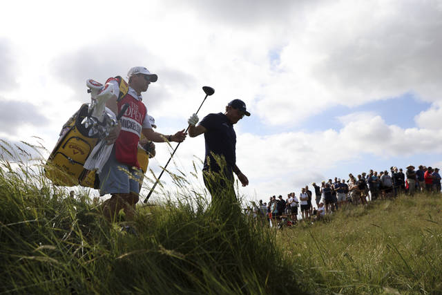 United States' Phil Mickelson walks off the 7th tee during the first round British Open Golf Championship at Royal St George's golf course Sandwich, England, Thursday, July 15, 2021. (AP Photo/Ian Walton)