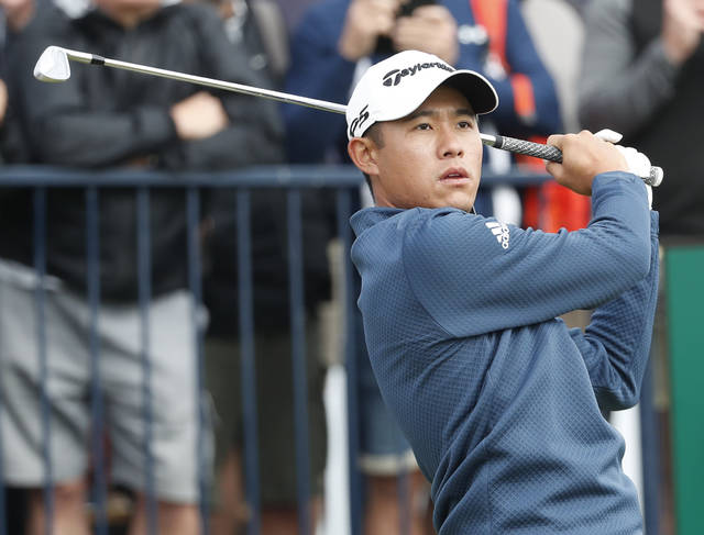 United States' Collin Morikawa plays his tee shot on the 3rd hole during the second round of the British Open Golf Championship at Royal St George's golf course Sandwich, England, Friday, July 16, 2021. (AP Photo/Peter Morrison)
