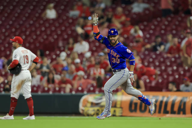 New York Mets' Michael Conforto gestures after hitting a solo home run during the 11th inning of a baseball game against the Cincinnati Reds in Cincinnati, Monday, July 19, 2021. The Mets won 15-11. (AP Photo/Aaron Doster)