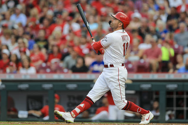 Cincinnati Reds' Joey Votto watches as he hits a solo home run during the third inning of a baseball game against the New York Mets in Cincinnati, Tuesday, July 20, 2021. (AP Photo/Aaron Doster)