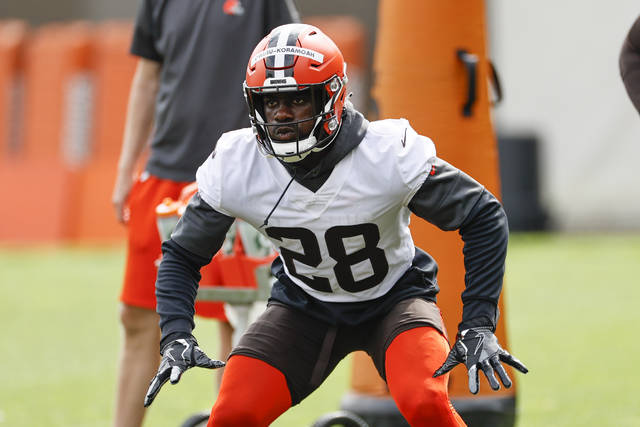 FILE - In this Wednesday, June 9, 2021 file photo, Cleveland Browns linebacker Jeremiah Owusu-Koramoah runs through a drill during an NFL football practice at the team's training facility in Berea, Ohio. Cleveland Browns rookie linebacker Jeremiah Owusu-Koramoah has tested positive with the COVID-19 virus just days before the opening of training camp. The team placed the second-round pick from Notre Dame on the COVID list Sunday, July 25, 2021.(AP Photo/Ron Schwane, File)