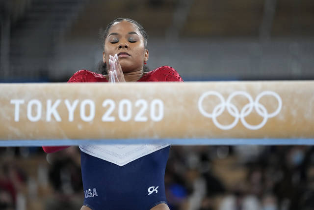 Jordan Chiles, of the United States, prepares to perform on the balance beam during the artistic gymnastics women's final at the 2020 Summer Olympics, Tuesday, July 27, 2021, in Tokyo. (AP Photo/Ashley Landis)