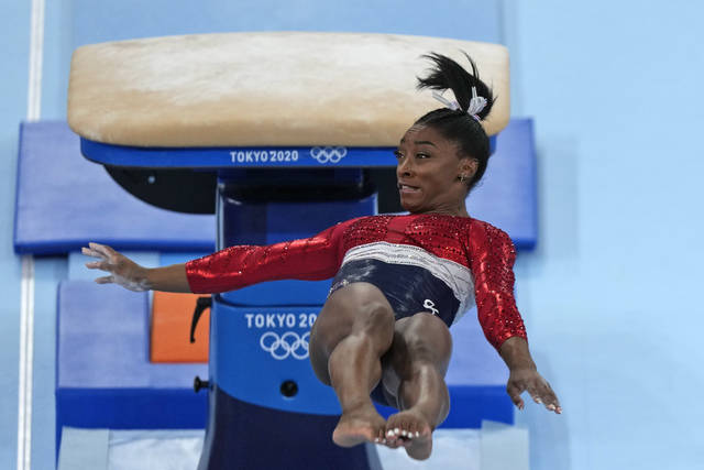 Simone Biles, of the United States, performs on the vault during the artistic gymnastics women's final at the 2020 Summer Olympics, Tuesday, July 27, 2021, in Tokyo. (AP Photo/Natacha Pisarenko)