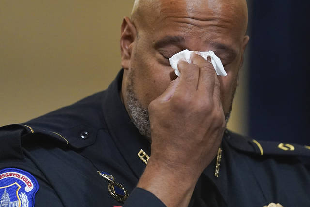 Washington Metropolitan Police Department officer Daniel Hodges wipes his eyes during the House select committee hearing on the Jan. 6 attack on Capitol Hill in Washington, Tuesday, July 27, 2021. (AP Photo/ Andrew Harnik, Pool)