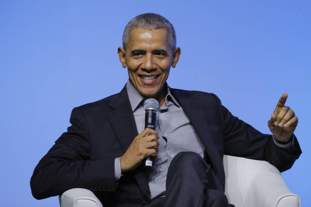 """FILE - Former U.S. President Barack Obama gesture as he attends the """"values-based leadership"""" during a plenary session of the Gathering of Rising Leaders in the Asia Pacific, organized by the Obama Foundation in Kuala Lumpur, Malaysia, on Dec. 13, 2019. Obama's memoir """"Dreams from My Father"""" will be released in a young adult edition on October 5. Obama had yet to hold any political office when """"Dreams from My Father"""" was released in 1995.  (AP Photo/Vincent Thian, File)"""