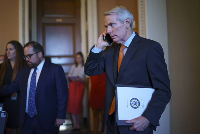 Sen. Rob Portman, R-Ohio, the lead GOP negotiator on the infrastructure talks, emerges from the office of Senate Republican leader Mitch McConnell to announce he has reached a $1 trillion infrastructure bill with Democrats and is ready to vote to take up the bill, at the Capitol in Washington, Wednesday, July 28, 2021. (AP Photo/J. Scott Applewhite)