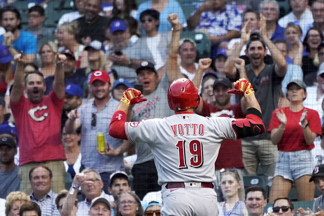 Cincinnati Reds' Joey Votto points to his name on his jersey after hitting a home run off Chicago Cubs starting pitcher Zach Davies during the second inning of a baseball game Wednesday, July 28, 2021, in Chicago. (AP Photo/Charles Rex Arbogast)