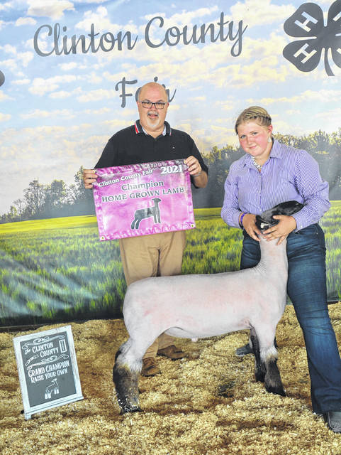 For Grand Champion Home Grown Lamb, shown are winner Kaydence Beam and judge Terry Burks.