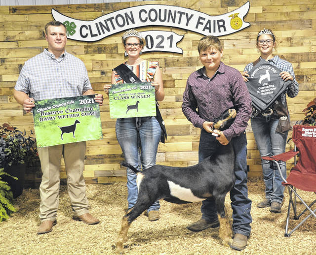 For the 2021 Clinton County Fair in the Market Goat competition, shown are Judge Luke Wechter, Fair Queen Shaleigh Duncan, Reserve Champion Dairy Wether Cory Kidd, and Goat Queen McKinzey DeBord.