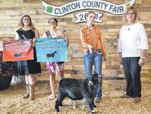 For Pygmy Goat Grand Champion Pygmy Wether and Overall Showman: From left are Fair Queen Shaleigh Duncan, Goat Queen McKinzey DeBord, winner Makayla Thomason, and Judge Julianne Krebs.