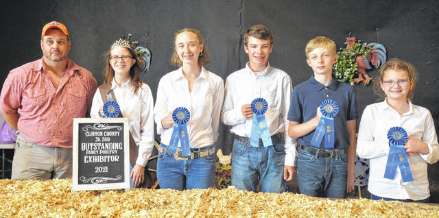 In the 2021 Clinton County Fair's Fancy Poultry Showmanship, from left are Judge Jamie Beneke with winners including: Senior 16-18 year-old & also Outstanding Fancy Poultry Exhibitor, Alyssa Hutchinson; Senior 14-15 year-old, Logan Shumaker; Intermediate 12-13 year-old, Warren Murphy; Junior 10-11 year-old, Maxwell McDermott; and Beginner 8-9 year-old, Ella DeMange.