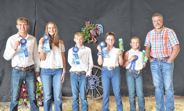 In Poultry Showmanship, Market Chicken winners at the 2021 fair: From left are 16-18 year-old, Aiden Hester; 14-15 year-old, Jozie Jones; 12-13 year-old, Isaak Ade; 10-11 year-old, Cassidy Bradley; 9 year-olds, Alia Hester; and Judge Mark Lange