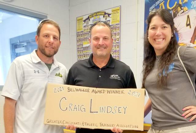 Craig Lindsey (middle) with Chris Bonnell (left) and Liz Ebbeler (right) as Lindsey was a surprise recipient of the Bill Walker Memorial Award.