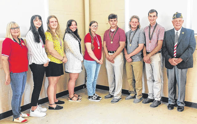 From left are Joyce Kelly, Annie Trovillo, Daelyn Staehling, Lacie Tedrick, Regan Grogg, Nate Coyle, Bryan Bandow, Jacob Lansing, and Chuck Culberson.