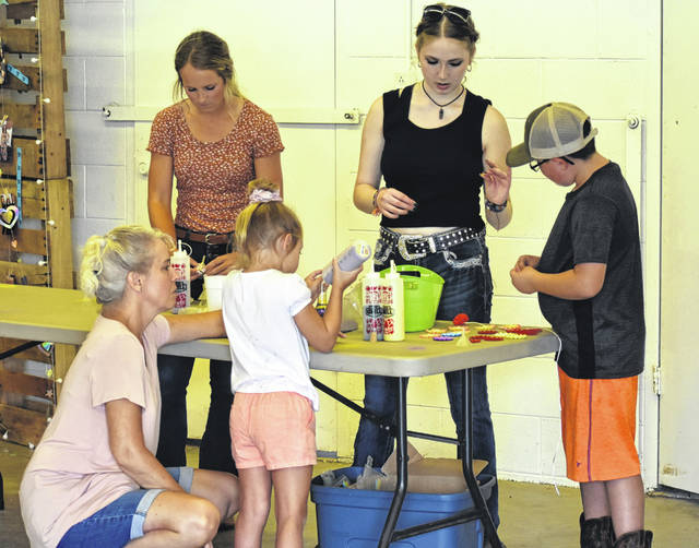 """Kids got to play games, do crafts, enjoy food, and kids even show """"kids"""" (goats) at the Clinton County Fair this week. For many more photos, see inside today's News Journal."""