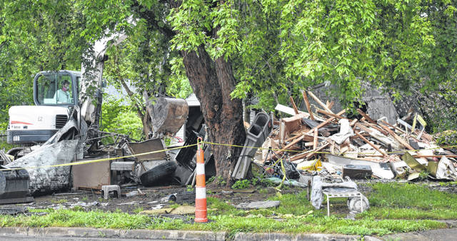The house at 92 Woodview Drive in Wilmington is razed on Tuesday.