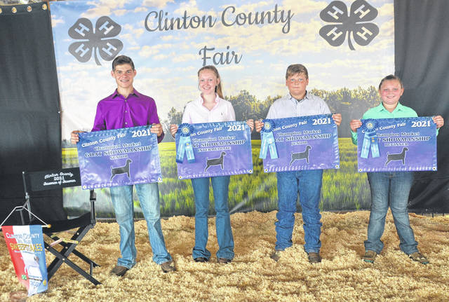 In the 2021 fair's Goat Showmanship: From left are Senior Showmanship & Overall Showman and Sweepstakes Representative Jaden Snyder; Overall Intermediate Showmanship winner Landree Stump; Overall Junior Showmanship winner Cory Kidd; and Overall Beginner Showmanship winner Mackenzie Strong.