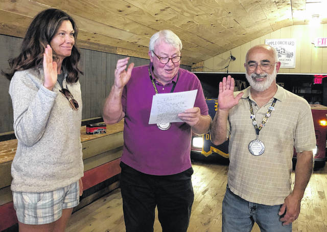From left, Michelle White is sworn in to fulfill the role of the club's Treasurer by now-Past President Mark McKay, and Past President Fadi Al-Ghawi is sworn in as the club's Sergeant-at-Arms.