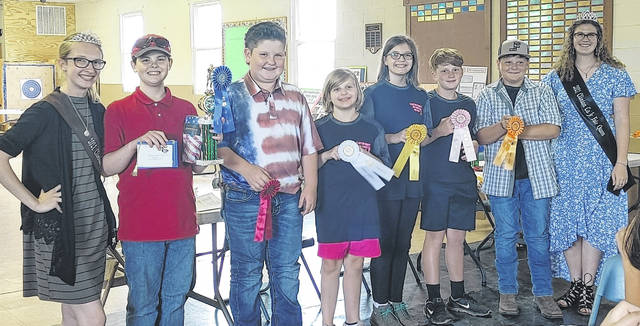 Junior Rifle winners. Pictured are Mikala Hatfield, Clinton County Family and Consumer Science Queen; first place Stanley Chesney; second place Cooper Dillion; third place Lily Brelsford; fourth place Hope Brelsford; fifth place Isaac Newberry; sixth place Cory Kidd; and Clinton County Fair Queen Shaleigh Duncan.