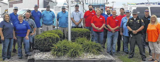 Members of the Clinton County Agricultural Society (Fair Board) assemble for opening ceremonies Saturday at the 2021 Clinton County Fair. They were joined by county officials and local law enforcement, which will perform special detail and provide security patrolling the fairgrounds.