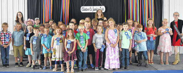 The two photographs show two sets of Clinton County 4-H Cloverbuds who took part in the Clinton County Fair's Cloverbud Revue. All the young children pictured received a participation ribbon in the non-competitive activity and experience. Kindergarten through second-grade children are eligible for the 4-H Cloverbud program.