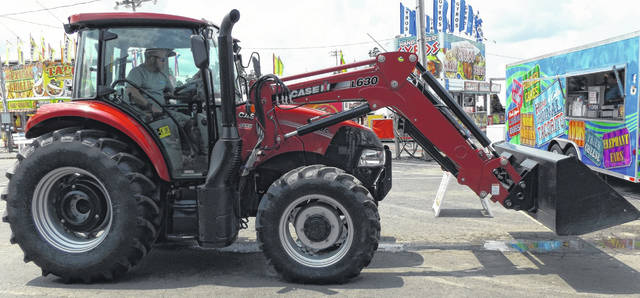 The Clinton County Agricultural Society recently bought a new tractor with a front-end loader, and what do you know, it arrived at the fairgrounds Wednesday during the week of the county fair.