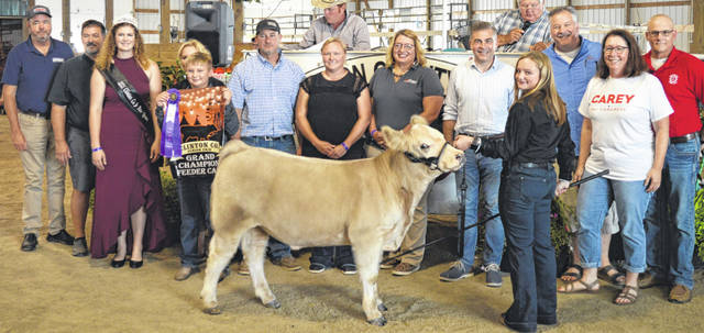 Taylor Barton's grand champion market feeder calf drew a $1,275 premium at the time of the livestock auction. The contributing sponsors include Ag-Pro, Alex Anderson & John Carney, American Equipment Service, Arehart-Brown Funeral Service LLC, ATSG (Air Transport Services Group), Barton Farms, Bronson Door Co., Bush Auto Place, Carey for Congress, DeBold Builders, Farm Credit Services, Groves Tire & Service, Halee Ann Photography, Hartley Oil Co., Lowes, Merchants National Bank, Neal Bond Seed Services, Schneder Farms Seaman Construction, Ron Trusty Insurance, and Wilmington Auto Center - Chrysler, Dodge, Jeep.