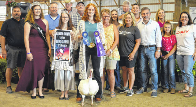Jozie Jones' grand champion market turkey raised an $875 premium at the time of the livestock auction. The contributing sponsors include American Equipment Service, Arehart-Brown Funeral Service LLC, Baker Boer Goats, BDK Feed & Supply, Carey for Congress, Cherrybend Pheasant Farm / Ellis Farms, Clinton Animal Care Center, D&E Equipment Co., First State Bank, Greater Tomorrow Health, Groves Tire & Service, Imagine That Tool Rental, Johnson Farms, Longs Pharmacy, Paul Hall & Associates / Justin Holbrook, Peoples Bank, Sunrise Cooperative, Tro Go Amish Recipe Pretzels and Doughnuts, Vital Fitness, and the Wilmington Auto Center - Chrysler, Dodge, Jeep.