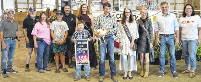 Warren Murphy's grand champion pen of three chickens brought an $850 premium at the time of the livestock auction. The contributing sponsors include A&M Farm Orchard, American Equipment Service, BDK Feed & Supply, Carey for Congress, Circle S Farms, D&E Equipment Co., D'Shealy Designs, Groves Tire & Service, Henry and William Hildebrandt, Johnson Farms, Liberty Savings Bank, Longs Pharmacy, Paul Hall & Associates / Justin Holbrook, Sams Meats, Hannah and Jacob Scott, Sunrise Cooperative, Tro Go Amish Recipe Pretzels, Doughnuts, Wagner Concession, and Wilmington Auto Center - Chrysler, Dodge, Jeep.