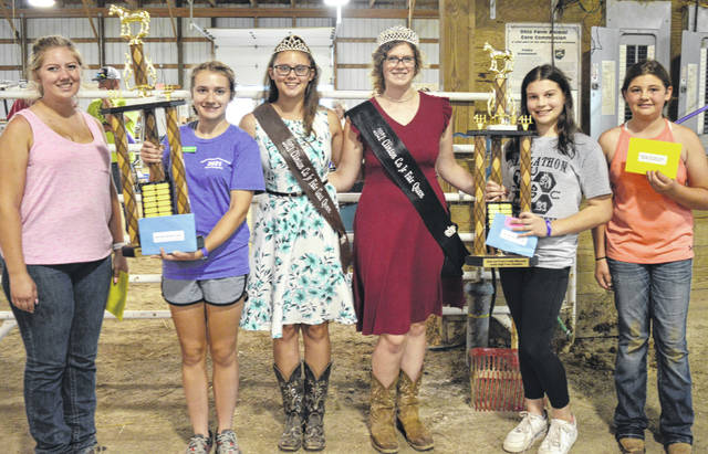 The Janet and Frank Fowler Memorial High Point Exhibitor awards (senior and junior divisions) were presented Friday at the Livestock Expo Center during the Clinton County Junior Fair Showman of Showmen Sweepstakes event. Second from left is High Point Exhibitor senior division winner Danica Henderson, and second from right is High Point Exhibitor junior division winner Claire Connor.