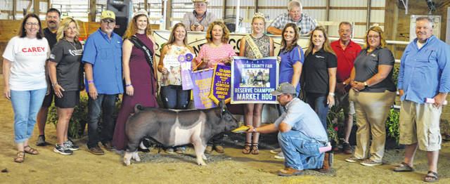 Kami Kile's reserve champion market hog pulled in a $2,125 premium at the time of the livestock auction. The contributing sponsors include Accurate Soils, Ag-Pro, Alexander-Gerber Crop Insurance, Ally Montague, Arehart-Brown Funeral Services LLC, ATSG (Air Transport Services Group), Autumn Years Nursing Center, Baker Boer Goats, Barton Farms, Bentley Pig Sale, Bob Peterson, Carey for Congress, Cherrybend Pheasant Farm / Ellis Farms, Cottage Lane Farms, Hartley Oil Co., Henry and William Hildebrandt, Imagine That Tool Rental, in memory of Rob Drake, Jeff and Sandy Hartman Family, Ron and Vicki Kendall, Blair Kenney, Kile Landscaping, M&K Show Stock, Martinsville Lions Club, McDonald & Sons Elevator, Neal Bond Seed Services, Noelle Singer Pinnacle Primary Care Physicians, Nutrien Ag Solutions, Parks Livestock, Pinkerton Family (Randy, Mindy, Josh), R+L Carriers, Sams Meats, Schneder Show Pigs, Simpkins-Foley Ins. / Foley & Achtermann, Smith Farms Trucking, Southern Hills Community Bank, Sue-Terres Food Affair, Wilmington Auto Center - Chrysler, Dodge, Jeep, and Brad and Angela Woodruff.