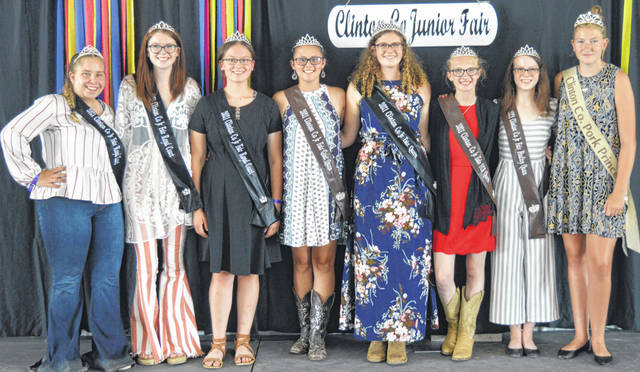 Much of the Clinton County Junior Fair royalty assembled together on stage for public recognition midway through a Sunday event in the Peterson Building. From left are Madison Abt of the junior fair court, Mackenzie Osborne of the court, Haley Dean of the court, Goat Queen McKinzey DeBord, Junior Fair Queen Shaleigh Duncan, Family & Consumer Sciences (FCS) Queen Mikala Hatfield, Poultry Queen Alyssa Hutchinson, and Pork Princess Emmy Chambliss.