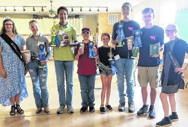 Pictured are all the first-place winners for the 4-H Shooting Sports judging in 2021. Shown are: Shaleigh Duncan, Clinton County Fair Queen; Anna Davis, Senior Pistol; Tony Wilens-Mabry, Senior Rifle; Stanley Chesney, Junior Rifle; Sydney Bennett, Junior Pistol; David Day, Senior Shotgun; Andrew Delph, Senior Archery; and Mikala Hatfield, Clinton County Family and Consumer Science Queen. Not pictured is Elizabeth Smith, Junior Shotgun.