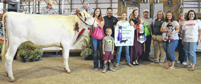 Maggie Mathews' supreme heifer brought a $1,950 premium at the time of the livestock auction. The contributing sponsors include American Equipment Service, ATSG (Air Transport Services Group), Caesar Creek Market, Phyllis Cocklin, Emma Mathews Photography, Gary Quallen Memorial, Happy Cows Creamery, Liberty Savings Bank, McConnell Veterinary Services, New Horizon Farm & Dairy, R+L Carriers, and the Wilmington Auto Center - Chrysler, Dodge, Jeep.
