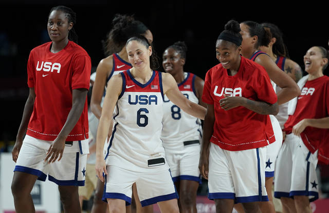 United States' Sue Bird (6) and teammates celebrate after their win in the women's basketball semifinal game against Serbia at the 2020 Summer Olympics, Friday, Aug. 6, 2021, in Saitama, Japan. (AP Photo/Charlie Neibergall)