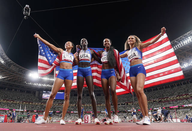 The United States team of Allyson Felix, Athing Mu, Dalilah Muhammad and Sydney Mclaughlin, from left, celebrate winning the gold medal in the final of the women's 4 x 400-meter relay at the 2020 Summer Olympics, Saturday, Aug. 7, 2021, in Tokyo, Japan. (AP Photo/Charlie Riedel)