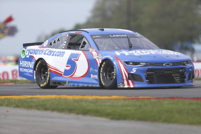 Kyle Larson drives through the Bus Stop during a NASCAR Cup Series auto race in Watkins Glen, N.Y., on Sunday, Aug. 8, 2021. (AP Photo/Joshua Bessex)