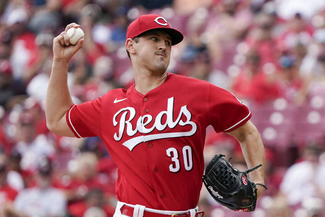 Cincinnati Reds starting pitcher Tyler Mahle (30) throws during the first inning of a baseball game against the Pittsburgh Pirates in Cincinnati, Sunday, Aug. 8, 2021. (AP Photo/Jeff Dean)