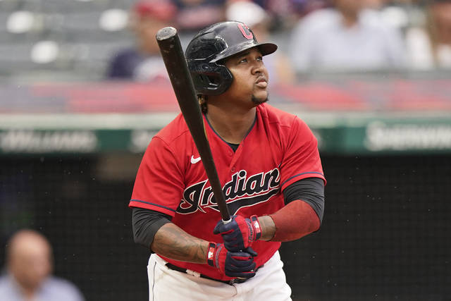Cleveland Indians' Jose Ramirez watches his one-run triple in the third inning of a baseball game against the Cincinnati Reds, Monday, Aug. 9, 2021, in Cleveland. (AP Photo/Tony Dejak)