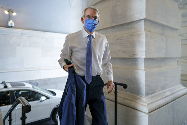Sen. Rob Portman, R-Ohio, the top Republican negotiator on the bipartisan infrastructure bill, arrives as a coalition of Democrats and Republicans push the $1 trillion bipartisan infrastructure package to a final vote, at the Capitol in Washington, Tuesday, Aug. 10, 2021. (AP Photo/J. Scott Applewhite)