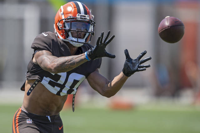 Cleveland Browns defensive back Greg Newsome II catches a football during an NFL football practice in Berea, Ohio, Wednesday, Aug. 4, 2021. (AP Photo/David Dermer)