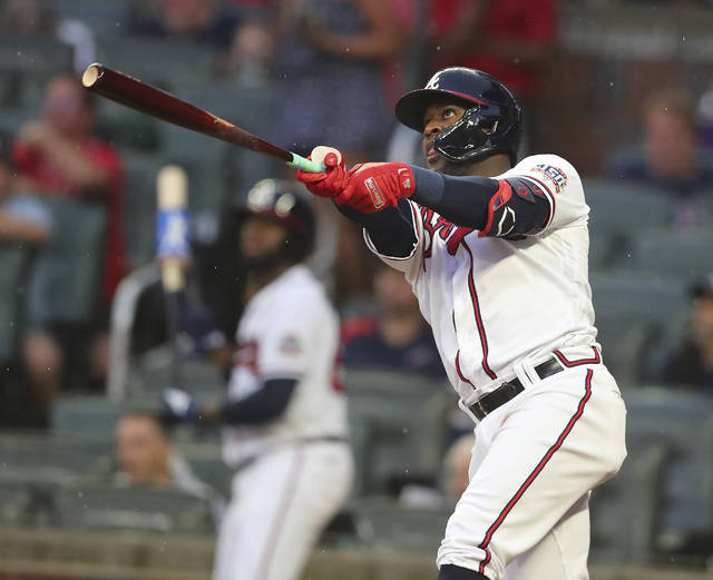Atlanta Braves' Guillermo Heredia watches his two-run home run against the Cincinnati Reds during the second inning of a baseball game Wednesday, Aug. 11, 2021, in Atlanta. (Curtis Compton/Atlanta Journal-Constitution via AP)