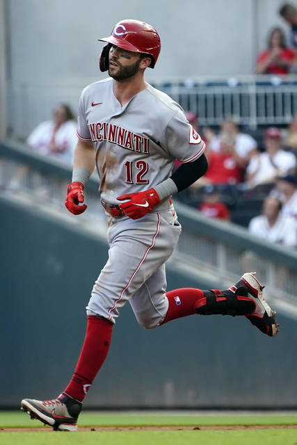 Cincinnati Reds' Tyler Naquin runs the bases after hitting a three-run home run during the third inning of the team's baseball game against the Atlanta Braves on Thursday, Aug. 12, 2021, in Atlanta. (AP Photo/John Bazemore)