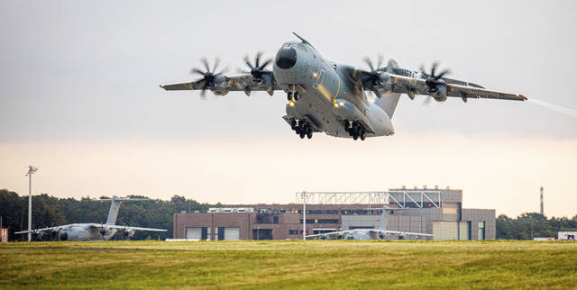 An Airbus A400M transport aircraft of the German Air Force takes off early this morning from the Wunstorf air base in the Hanover region Monday, Aug. 16, 2021. In view of the rapid advance of the Taliban in Afghanistan, the Bundeswehr wants to begin evacuating German citizens and local Afghan forces from Kabul. (Moritz Frankenberg/dpa via AP)