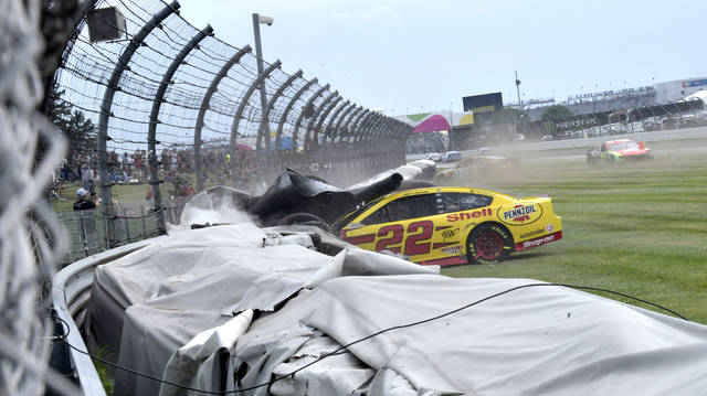 Joey Logano (22) crashes into a tire wall during a NASCAR Series auto race at Indianapolis Motor Speedway, Sunday, Aug. 15, 2021, in Indianapolis. (Randy Crist/The Indianapolis Star via AP)