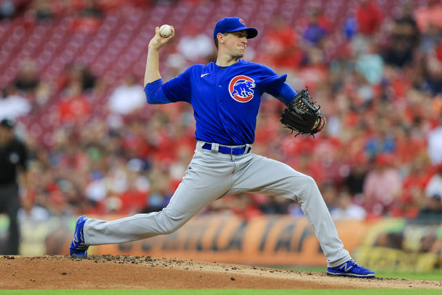 Chicago Cubs' Kyle Hendricks throws during the first inning of a baseball game against the Cincinnati Reds in Cincinnati, Tuesday, Aug. 17, 2021. (AP Photo/Aaron Doster)