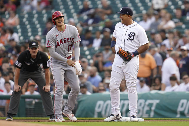 Los Angeles Angels' Shohei Ohtani (17) laughs while at first base with Detroit Tigers first baseman Miguel Cabrera (24) in the first inning of a baseball game in Detroit, Tuesday, Aug. 17, 2021. (AP Photo/Paul Sancya)