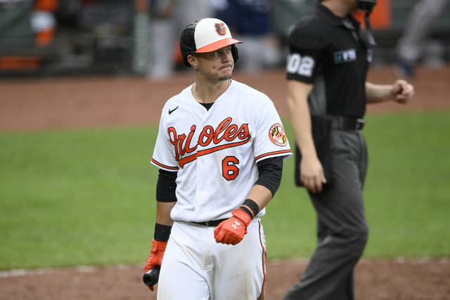Baltimore Orioles' Ryan Mountcastle walks back to the dugout after he struck out swinging during the seventh inning of a baseball game against the Atlanta Braves, Sunday, Aug. 22, 2021, in Baltimore. (AP Photo/Nick Wass)