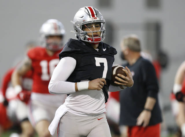 FILE - Ohio State quarterback C.J. Stroud runs through a drill during an NCAA college football practice in Columbus, Ohio, in this Monday, April 5, 2021, file photo. Third-year Ohio State coach Ryan Day opens a preseason camp for the first time without a good idea of who will be the starting quarterback. (AP Photo/Paul Vernon, File)